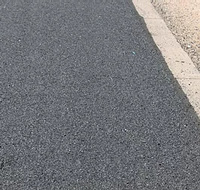 Photo of pavement that uses Sharpshot as a component